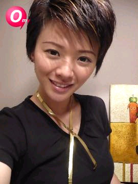 Mindee Ong with golden ribbon