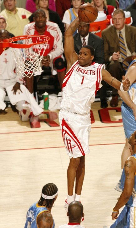 Tracy McGrady takes it strong to the hole for a jam after blowing by Denver's Eduardo Najera (not pictured) in the first quarter Sunday night.  In Yao Ming's absence, Tracy McGrady led all scorers with 22 points, 6 rebounds and 6 assists in one of his finest games of the season.  The Rockets beat the Nuggets for their 15th game in a row, which ties a franchise record.