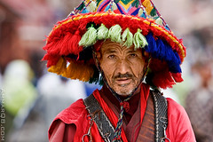 Moroccan Water Man (Ammar Alothman) Tags: africa city travel portrait people colors hat canon morocco maroc medina marrakesh kuwait 70200 waterman ammar kw 2007 q8 30d canon70200 canon30d   vwc redclothes  ammaralothman 3mmar  3amar kuwaitiphotographer ammarq8 kvwc kuwaitvoluntaryworkcenter  kuwaitvwc jameaalfana