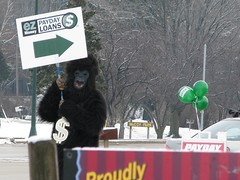 just how bad is your job? (gblackwell) Tags: trees winter snow sign wisconsin canon balloons monkey is store check highway gorilla jewelry suit sidewalk dollar bling s5 cashing s5is