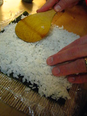 Putting on the Sushi Rice