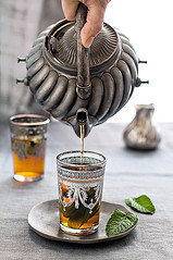 moroccan mint tea 1415.jpg (skrockodile (www.cookbookcatchall.blogspot.com)) Tags: brown window glass silver grey purple tea mint pouring moroccan foodphotography mywinners