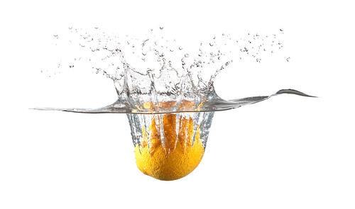 Lemon splashing in water
