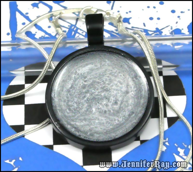 Swirls of Liquid Silver Resin Black Round Necklace