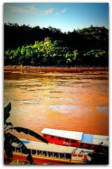 Mekong River Boats | Luang Prabang (I Prahin | www.southeastasia-images.com) Tags: travel roof heritage tourism beautiful architecture river boats design buddha buddhist royal palace tourist unesco monks temples tropical historical laos mekong luangprabang worldheritage louangphrabang landofamillionelephants luangprabangtemple