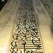 Arabic Writings racing up the marble walls of the Taj Mahal