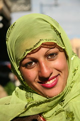 Girl in Green (hazy jenius) Tags: trip travel portrait woman green girl beautiful smile colorful veil muslim islam headscarf middleeast hijab adventure backpacking journey syria niqab deirezzur deirezzor deirazzur