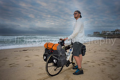 Adventure Cyclist with Bicycle on Beach (JFJacobszPhotography) Tags: overland elements bicycle discover long young weight gear explore ready packspanniers hybrid beach road supplies journey intrepid experience far stamina go single white sidewalk twenties loaded bags tent back travel time alive sunrise one weather side sea earlymorning ride man adventure ocean distance open packed overlanding cloudy front luggage early frame life gearedup