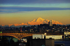 Snow-covered Mount Baker in the golden light of the setting sun (peggyhr) Tags: blue trees red sky orange white snow canada mountains vancouver clouds buildings wow gold bc eveningsun harmony burrardinlet faves 50 mountbaker artisan secondnarrowsbridge finegold thegalaxy 50faves peggyhr flickrawardgroup damncoolphotographersintheworld naturemasterclass afeastformyeyes exquisiteart 100commentgroup viterra yourbestoftoday creativephotographeronflickr bestpeopleschoice mygearandme ♣the ringexcellence thegalaxyhalloffame redgroupno1 stimmungendersonne yellowgroupno2 vivalavidal1 niceasitgets~level1 frameit~level01~ musictomyeyes~l1 ♣myhatsofftoyou ♣scapes wheatelevators p1070370a lifeisgreat㋡cestlaviesoistdasleben lumen☀zauberdeslichtes☼magiclight✺
