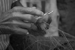 Le mani del pescatore (Calibano69) Tags: blackandwhite bw italy blackwhite nikon italia mare wb bn sicily palermo pesca sicilia biancoenero pescatore cefalù reti d80 mywinners nikond80 afsdx55200f456g