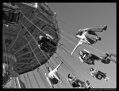 Reach Out (shutterBRI) Tags: autumn friends bw fall monochrome canon fun photography photo october ride action statefair swings northcarolina fair raleigh powershot carolina midway 2007 a630 ncstatefair shutterbri brianutesch photofaceoffwinner photofaceoffplatinum pfogold statefairofnorthcarolina brianuteschphotography