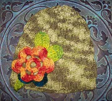 Swirl Hat with Wollmeise Flower