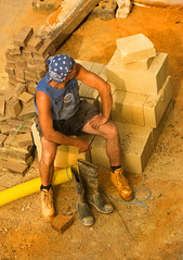 End of Day (mnadi) Tags: sunset man building men texture muscles work construction nikon boots candid bricks working bodylanguage menatwork achievement tired worker d200 builder workboots