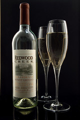 Redwood Creek Pinot Grigio (Photoshoparama - Dan) Tags: glass wine bottles sb800 champagneflutes strobist ebaytrigger johnsongraphics photoshoparama danielejohnson crossroadonecom redwoodcreekpinotgrigio