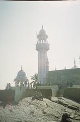 a view from the outside (Jennifer Kumar) Tags: muslim islam tomb bombay mumbai negativescan india1998