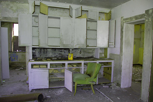 upholstered chair in abandoned kitchen-Chaska, Minnesota