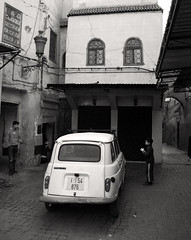 Car Part (stevec77) Tags: road street houses blackandwhite bw house car kids buildings d50 streetlife streetscene nikond50 renault morocco maroc marrakech cobbles renault4  londonmarrakech