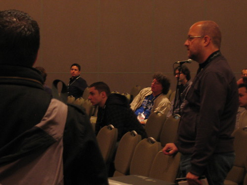 Jim Corbett in the audience in the blue and grey, talking to Colin Moock about ECMAScript 4 and ActionScript.
