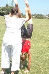 Ruth doing hand stands @ The Finish (by Louis Rossouw)