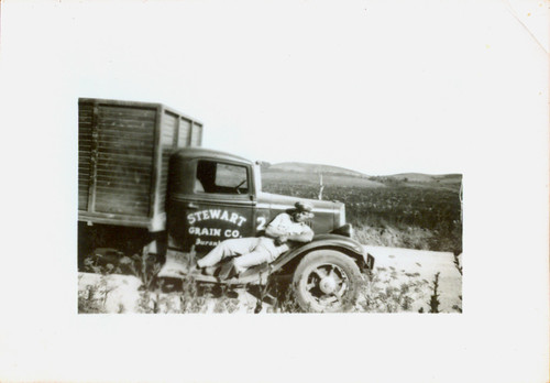 """Stewart Grain Co."" A man and his truck 02"