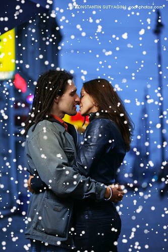 romantic couple kissing in the rain. Young couple kissing in a city