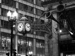 Marshall Field's clock in the snow (rebecca whitney) Tags: winter light blackandwhite bw snow chicago clock downtown thankyou macys marshallfields explored exploreddecember302007 326accordingtoscout