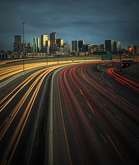 Speed of Light (Lightvision []) Tags: city longexposure travel light sunset red vacation usa motion building cars tourism car sport skyline architecture clouds speed america skyscraper lights hotel office football highway colorado downtown cityscape technology nightscape traffic stadium capital illumination fast overpass motel tunnel front denver business pollution co getty rushhour interstate curve broncos range hdr i25 lighttrail photomatix explored