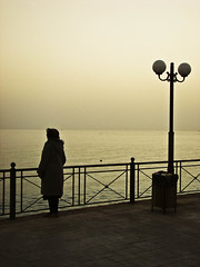(stelio B ) Tags: sunset sea sky woman moon black lamp greek evening alone view angle sony air cybershot athens greece attica h7   sonycybershoth7