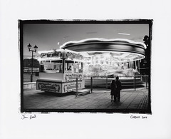 carousel , cardiff (Dan_wood) Tags: sea people bw water wales children bay fairground cardiff carousel cardiffbay