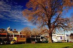 logistical assistance (mugley) Tags: park city houses winter sky tree grass clouds corner truck nikon d70 australia victoria streetscape urbanlandscape westmelbourne polariser curzonst millerst 1855mmf3556gii radioparts