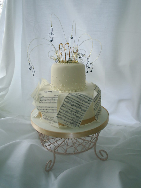 Red velvet cake with raspberry buttercream and edible sheet music of Happy
