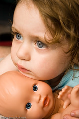 Young girl and her dolly (BACHarbin) Tags: family portrait usa girl female sadness kid still eyes hands doll quiet child looking faces candid blueeyes thoughtful va babydoll pensive dolly staring youngster unsure reston submittedtophotoshelter