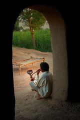 I Don't Know What Was Going On In His Mind, Any Guess ? (Amir Mukhtar Mughal | www.amirmukhtar.com) Tags: pakistan light people field bed village smoking crop amir thinking punjab vegitation amirphotography