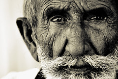 encounter (~FurSid) Tags: old pakistan portrait people face lines portraits eyes faces meetup expressions age portraiture duotone cracks emotions soe sindh encounter ih themoulinrouge pck littlestories twtmeblogged artlibre anawesomeshot impressedbeauty flickrchallengewinner bhitshah theunforgettablepictures platinumheartaward tup2 picswithsoul shahabdullatifbhitai