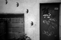 009 (Blacknoise) Tags: door urban brick film home wall 35mm graffiti diy stencil decay leeds delta olympus xa2 400 push analogue xa process developed hc ilford pushprocess ilforddelta ilfotec