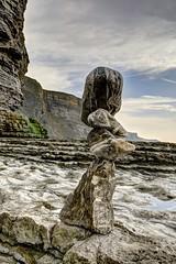 Love gets dangerous (pauldunn52) Tags: beach art pebbles balance temple bay
