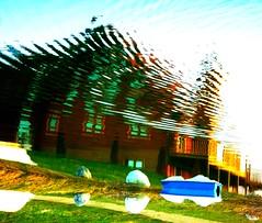 Water Art: Collapsing reflections (peggyhr) Tags: blue windows chimney sky orange brown white lake canada reflection water beautiful grass lines clouds golden amber boat rocks path teal shoreline logs windy deck alberta showroom ripples reflexions slope pedalboat loghouse myflickrfavs flippedreflection 25faves diamondheart peggyhr diamondstars colourartaward shining★star thebestshot ddsnet thedigitographer artofimages dragonflyawards creativeyeuniverse hablahispana sapphireawards pegasusaward tufotoesarte artnetcontemporaryartist poppyawards lomejordemisamigos ringexcellence avpa1maingroup royalgr☮up p1290291ap nluebirdestates