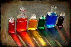 I Caught a Rainbow (Ali QJo) Tags: water rainbow bottles textured glassbottles foodcoloring coloredwater project365 top20colorpix karmapotd isawyoufirst thatsclassy betterthatgood thanksforthetitlemichelle alijohnsoncom