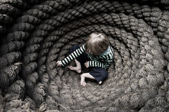 Little boy in a pot of ropes