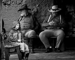 Reenactors on a Break (Jose Matutina) Tags: boots boy break caifornia calico civilwar raincoat reenactment reenactors sel85f14gm sonya7ii yermo