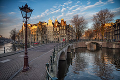 Golden light (angheloflores) Tags: amsterdam winter golden hour sunset canal houses clouds sky colors bridge lights travel architecture cityscape urban explore netherlands
