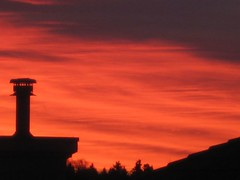 IMG_0572 (peggyhr) Tags: light chimney sky sun canada colour fall yellow clouds sunrise edmonton silhouettes alberta mauve oran 2007 rooflines peggyhr