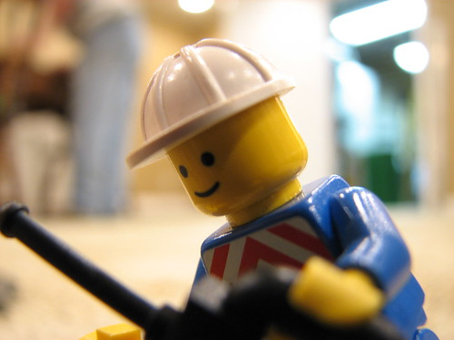 A lego minifig (miniature person), who happens to be a railway worker.
