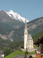 Heiligenblut, Austria (suesurridge) Tags: panorama mountains alps salzburg church water sunshine austria village spires lakes eu carinthia zellamsee osterreich grossglockner hohetauern heiligenblut karnten