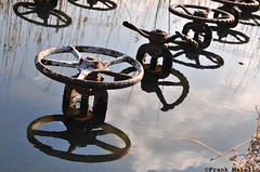 handwheels (frank maiello) Tags: sky reflection water rust tag valve nikkor submerged handwheel 1755f28