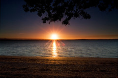 Beach Sunset (Chris Gin) Tags: sunset newzealand sun beach nature water silhouette auckland nz flare pointchevalier ndfilter ptchev gndfilter supershot neutraldensity graduatedfilter mywinners naturewatcher goldstaraward