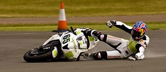 Down and ouch!! (Whooshka) Tags: world park uk greatbritain england fall race honda championship unitedkingdom crash jonathan kate slide off motorbike 100views ten gb motorcycle british circuit rea 65 whoops practise donington superbikes mortorcycle hannspree whooshka