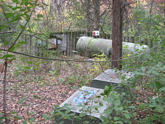 Wooded Industrial Outpost (The Joy Of The Mundane) Tags: wood trees color colour tree green water leaves electric forest fence found wooden leaf woods rust paint industrial tank decay pipes pipe ruin rusty flake utility gas hidden rusted peel electrical flaking flaky peeing ruined