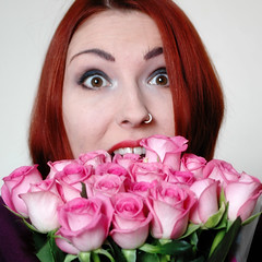 surprised and smiling with flowers