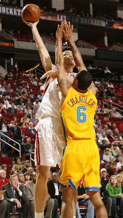 Yao Ming shoots a long beautiful jump shot over New Orleans' Tyson Chandler.  Yao was geat in scoring 30 points, snagging 16 boards, and rejecting 4 shots, but the Hornets were too much to handle in an 87-82 loss, halting Houston's 5-game winning streak.